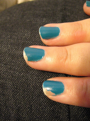 Chipped Blue Nail Polish